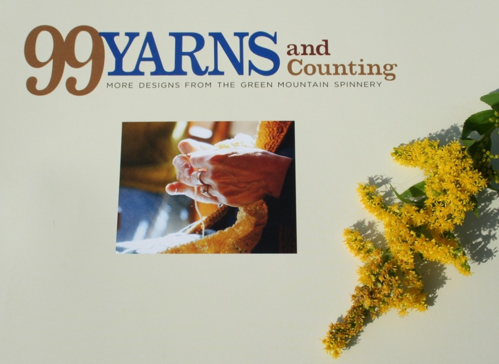 99 Yarns and Counting: More Designs from The Green Mountain Spinnery is the newest book of patterns and designs, published by The Countryman Press of Woodstock, Vermont. Photo of the opening page with a spray of goldenrod from a summer meadow, Moo Dog Knits Magazine.