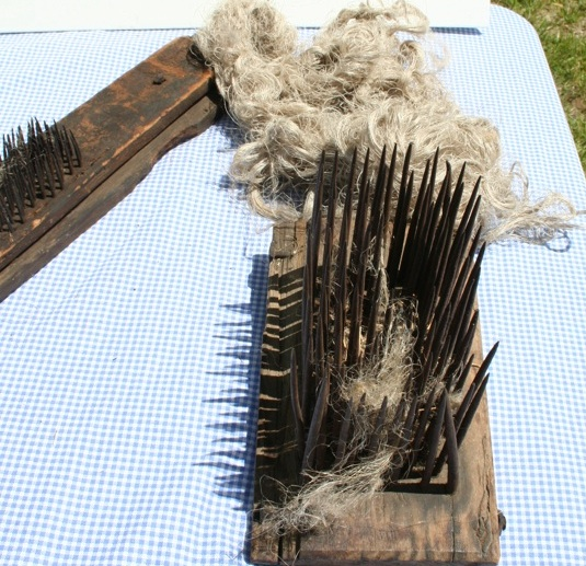 Turning flax into linen takes work. This is a hackle. Some call it a heckle - and it is used to comb short fibers out. Moo Dog Knits Magazine.