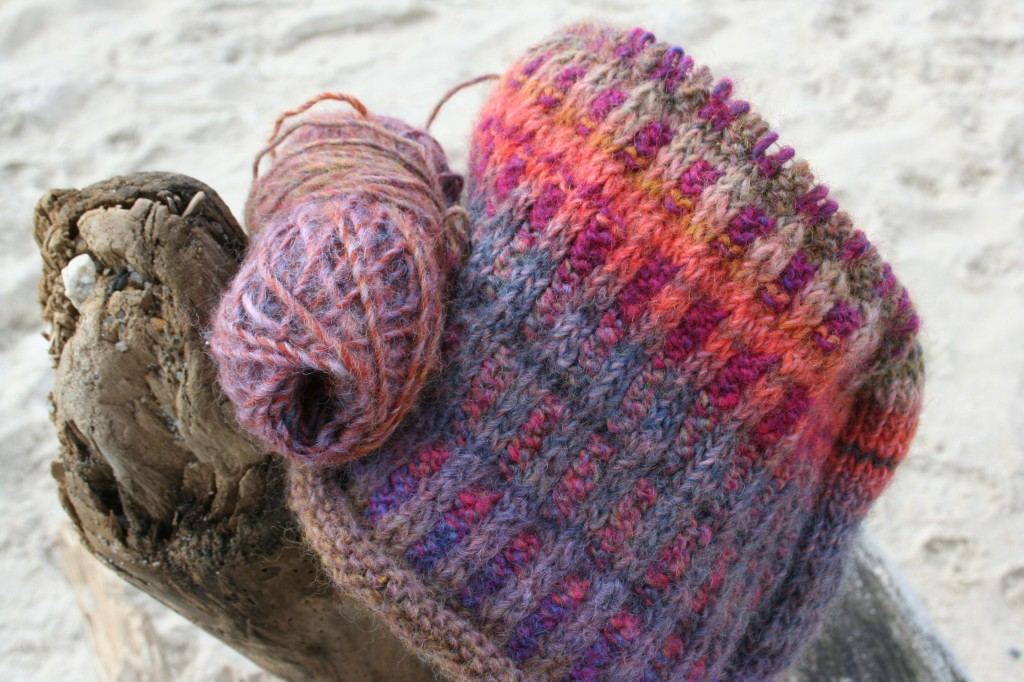 Color changing yarn work in progress on the beach, Moo Dog Knits Magazine.