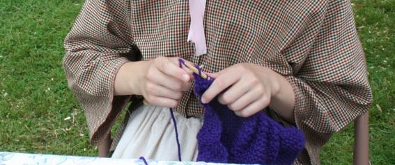 Young knitting hands. Moo Dog Knits Magazine.