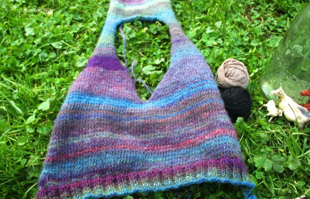 A child size v-neck vest knit in tonal yarn. Moo Dog Knits.