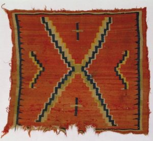 A hand-dyed and woven Native American saddle blanket.