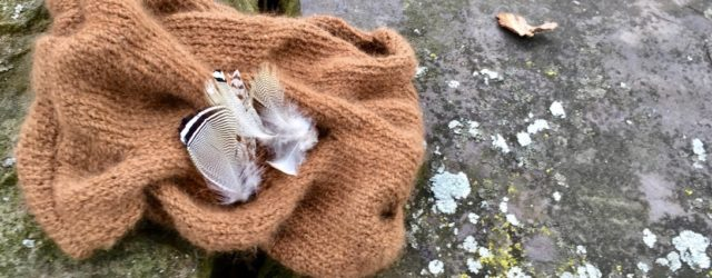 Feathers on a hand knit cowl. Photo Moo Dog Knits